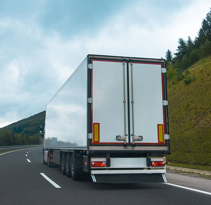 Semi truck driving on the road